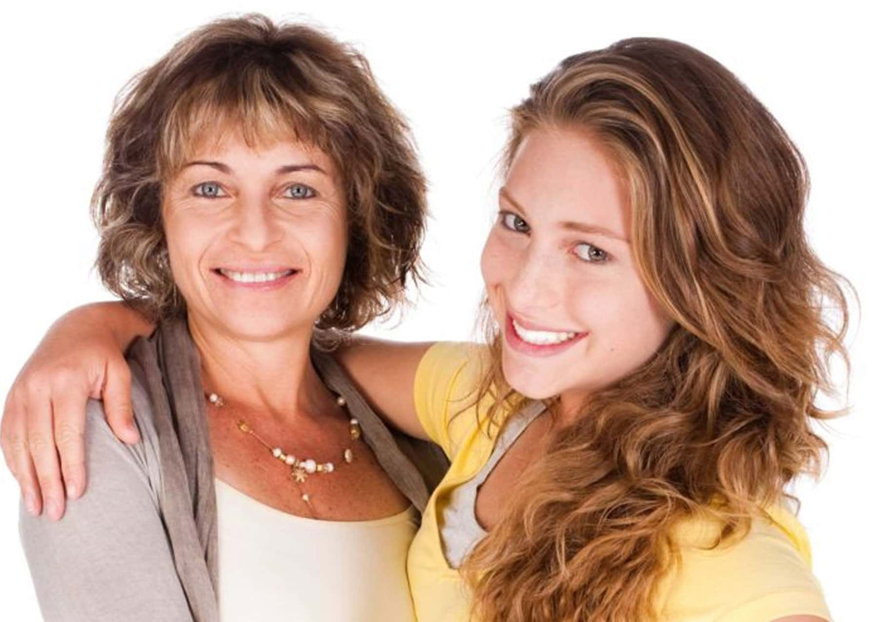Mother and daughter are having fun during Invisalign procedure