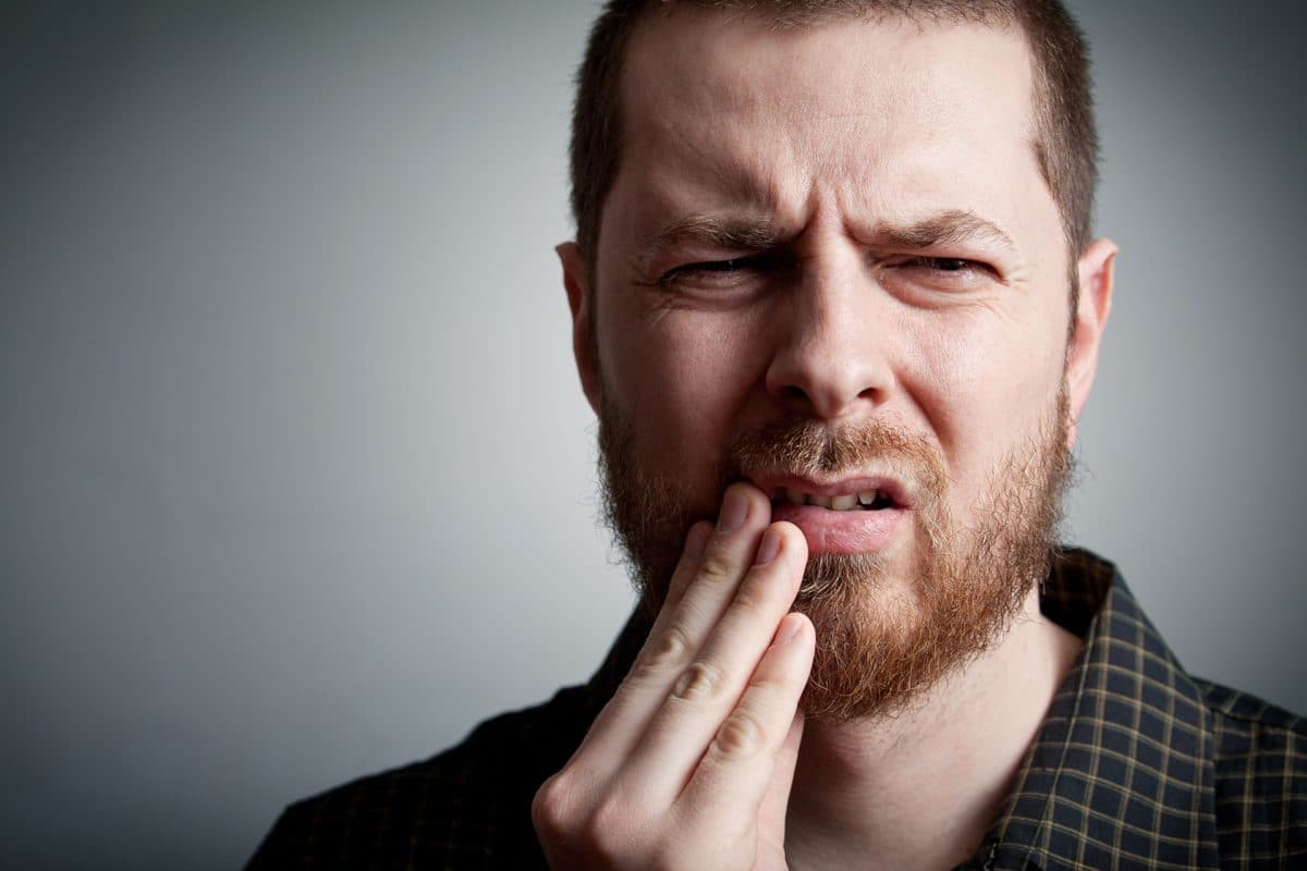 Man in intense pain due to severe toothache at Princeton NJ