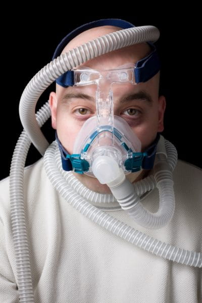 Happy and healthy middle age man wearing Cpap mask at Princeton NJ