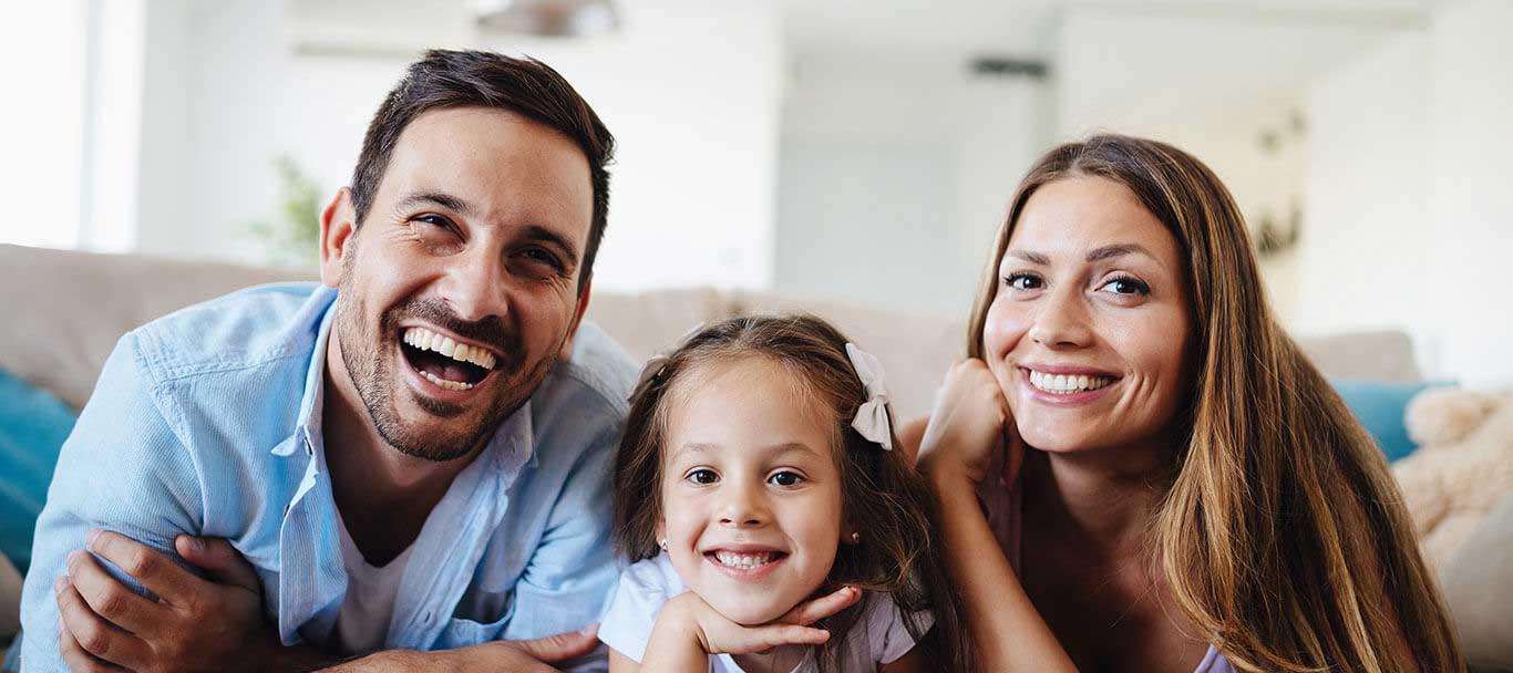 a healthy family awaits their dental visit at Princeton Park Dental